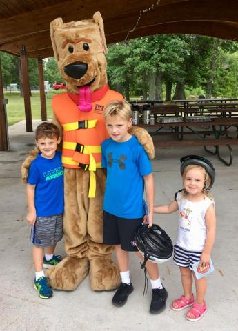 Special guest, Bobber the Water Safety Dog shown here making an appearance with Fishing Derby contestants.