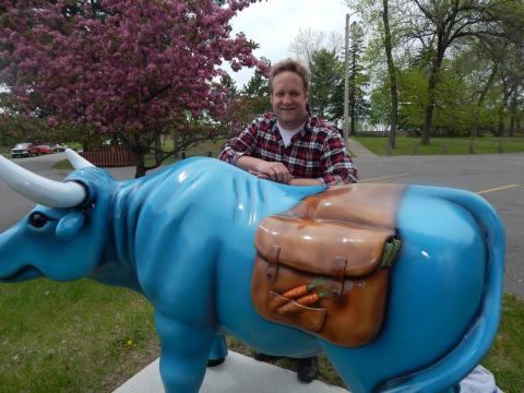 Babe the Blue Ox carries in his saddlebags garden vegetables you may find in a local community garden.