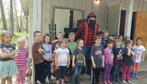 Paul Bunyan reads to Kindergarten students from Crosby Schools