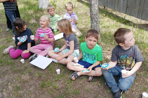 Kindergarten students from Crosby Schools enjoy a snack break during their field trip, enjoying Paul Bunyan decorated cookies baked specially at Pine River Bakery, Pine Rive.