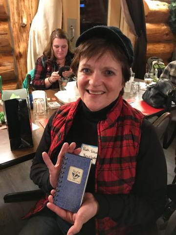 Ruth Schwieters received a handy pocket-sized vacation diary. Perfect timing for your next winter getaway. Love your plaid cap and vest, Ruth!