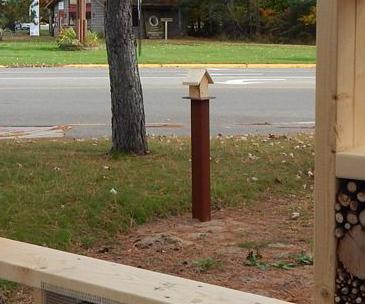 Bird feeder, donated by MN Backyard Birds is installed near the entrance to Linda Ulland Memorial Gardens.