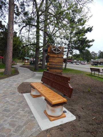"""A double treat of """"Minnesota's S'more Capital"""" benches along the Gardens walkway."""